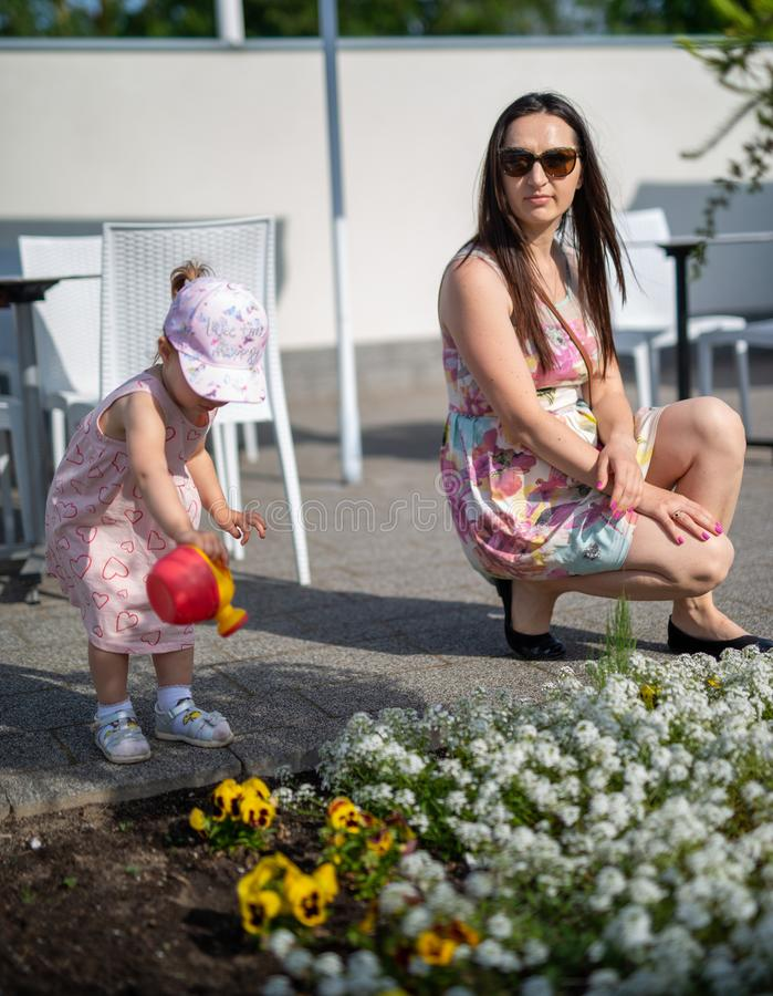 Little girl spending fantastic time on playground. Happy childhood. Authentic image. Baby, toddler, caucasian, kid, park, fun, outdoor, summer, joy, cute royalty free stock photography