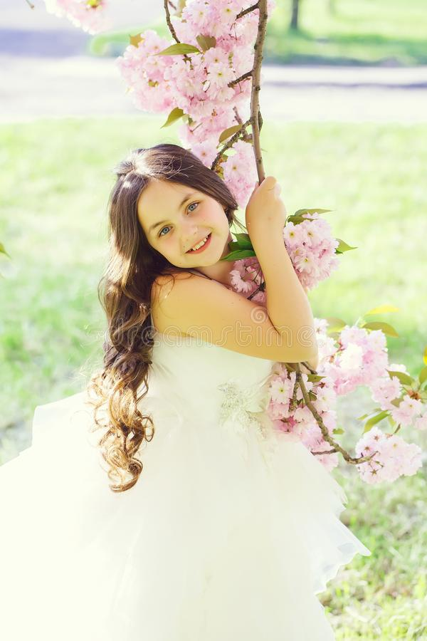 Little girl in spring bloom stock photography