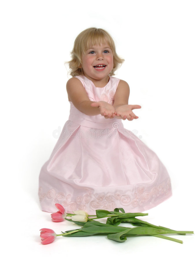 Little girl in spring dress. A little girl in a spring dress with hands out stock photos