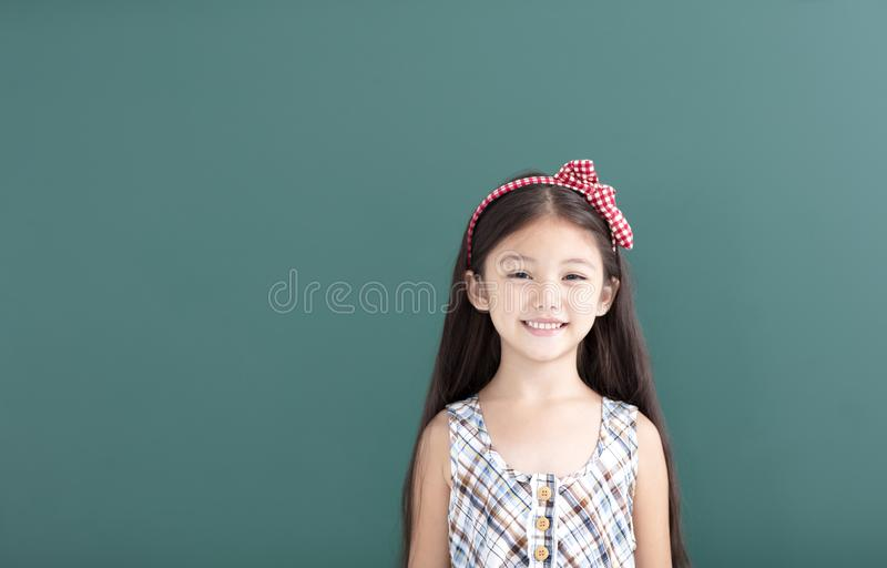 little girl stand before empty chalkboard royalty free stock images