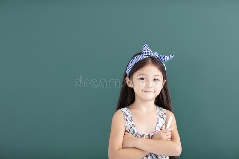 little girl stand before empty chalkboard royalty free stock photos