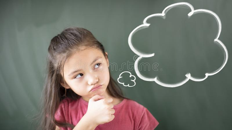girl standing against chalkboard with thinking bubble royalty free stock images