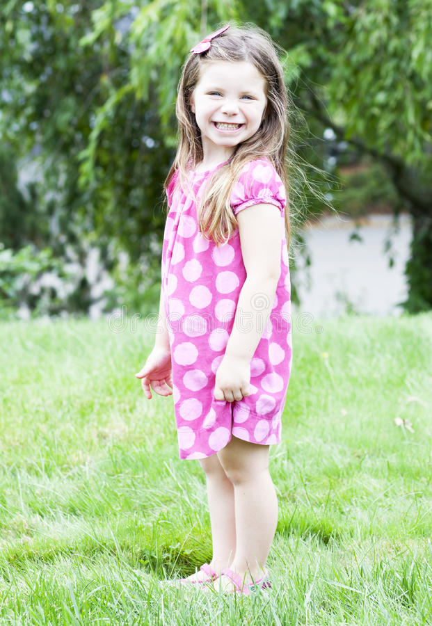 Download Little Girl Standing In Grass Stock Image - Image: 26671989
