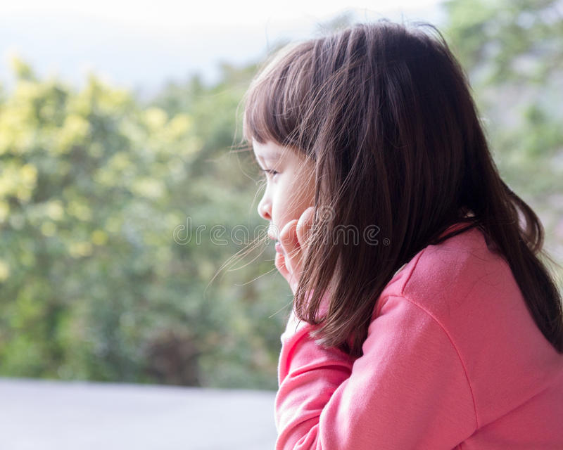 Little girl staring into nature royalty free stock images