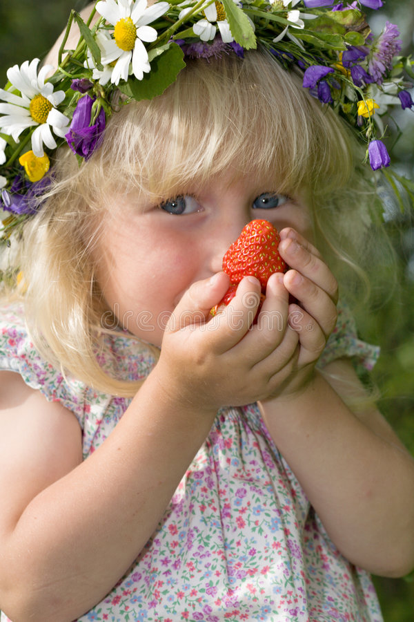 Little girl with strawberries in hands royalty free stock photos
