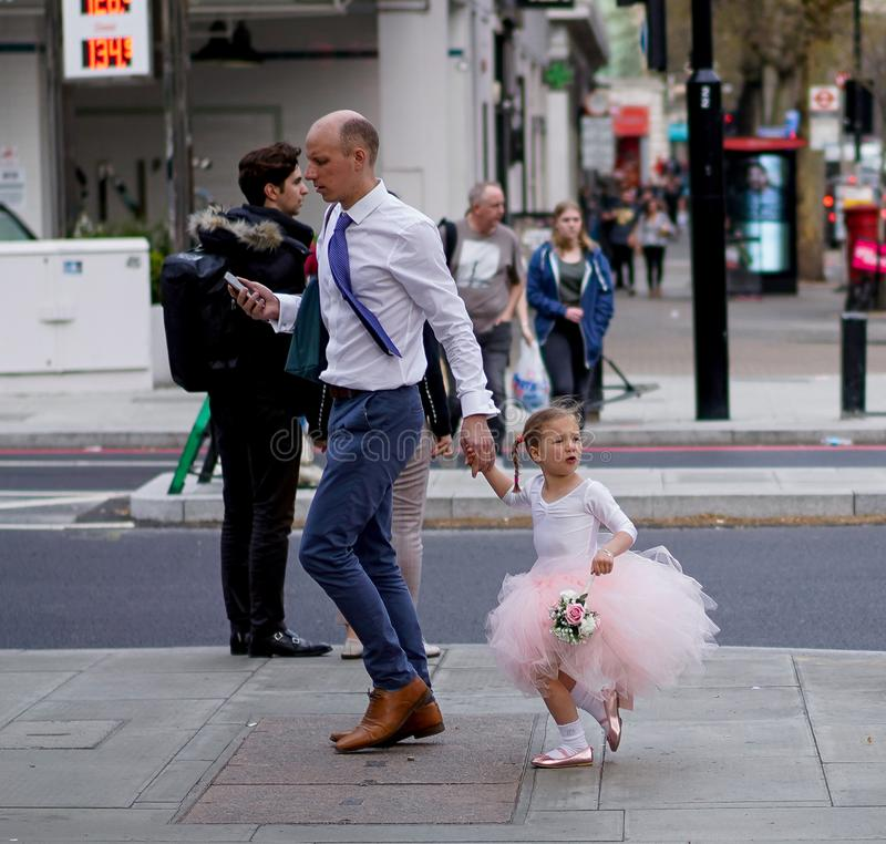 Little ballerina girl in the streets of London royalty free stock images