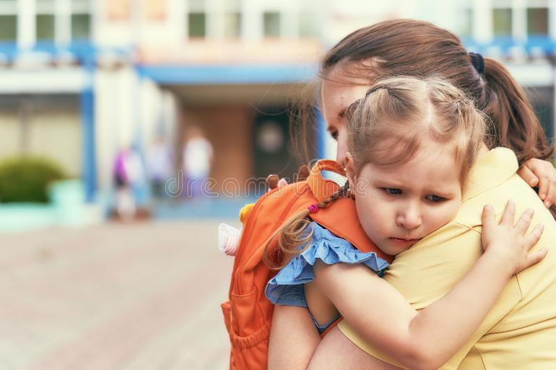 The little girl stress she does not want to leave her mother royalty free stock photo