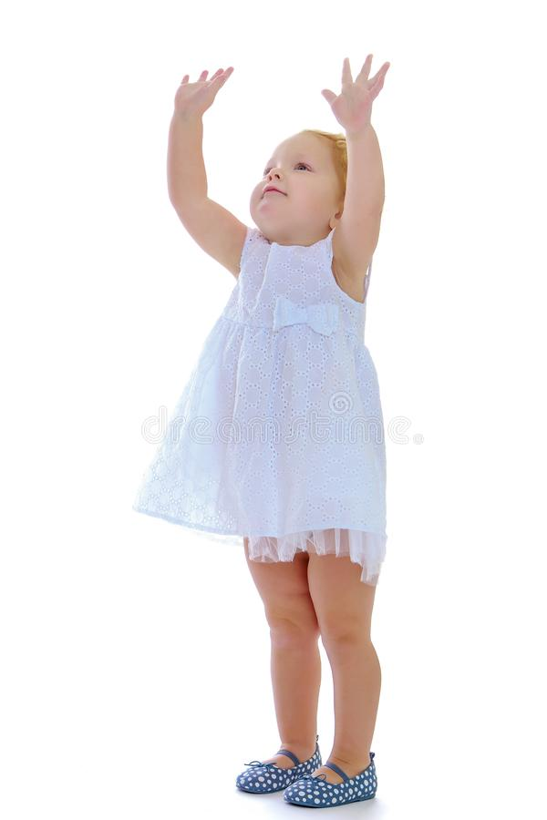 The little girl stretches her arms forward. royalty free stock photos