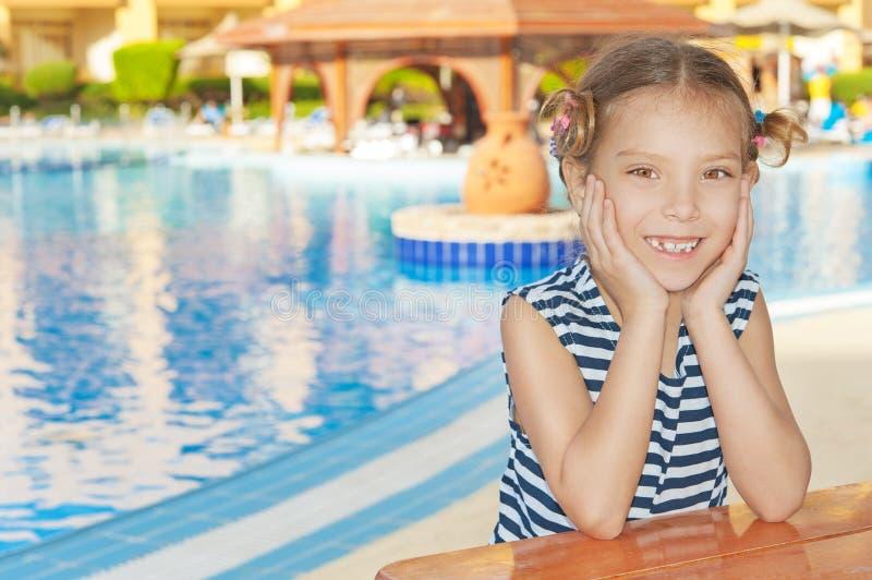 Little girl in striped vest near royalty free stock photo
