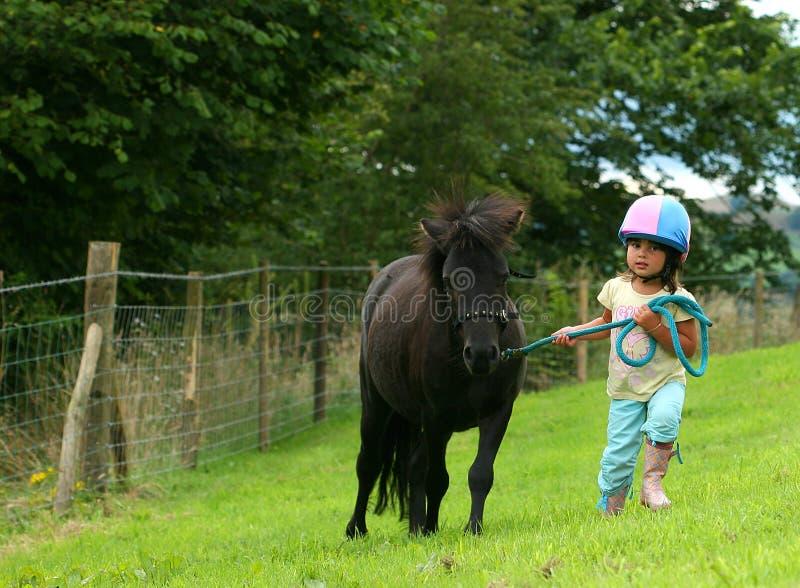 Little Girl Struggling stock images