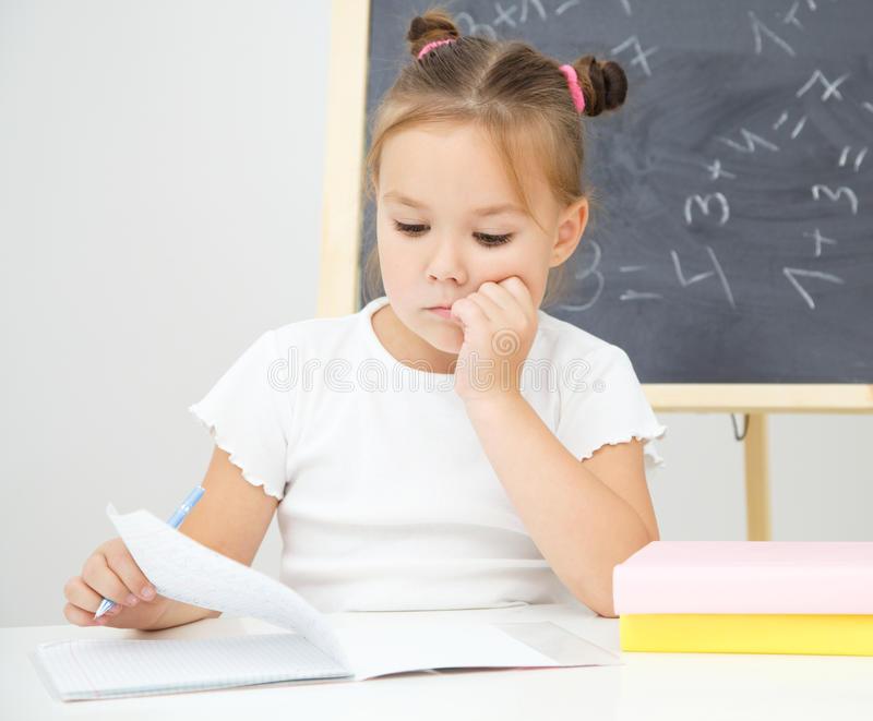 Little girl is studying. Cute little girl is studying in preschool stock image