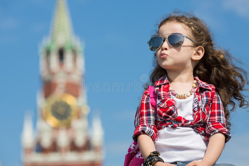 Little girl in stylish dress and sunglasses sitting stock photos