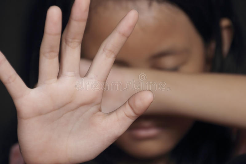 Little Girl Suffering Bullying. Raises her palm asking to stop the violence royalty free stock photos