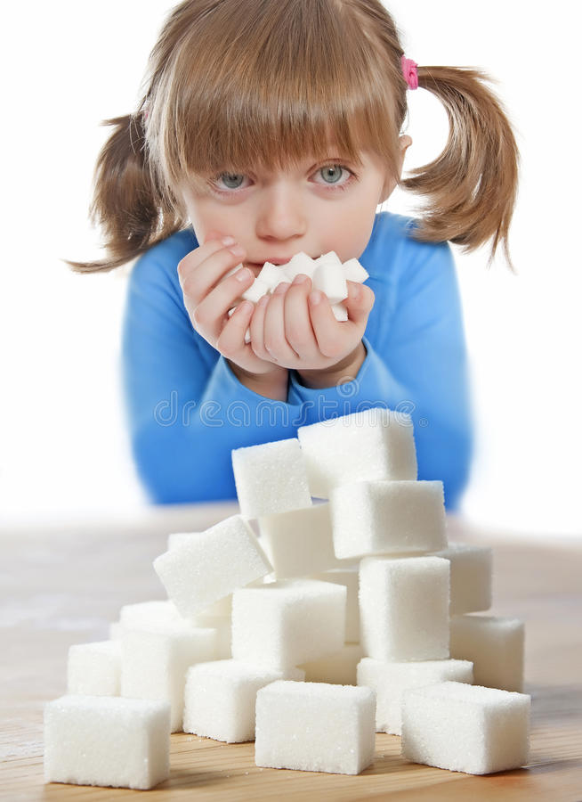 Little girl with sugar stock images