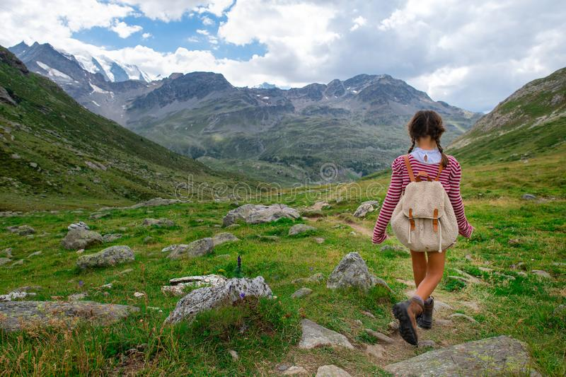 Little girl during a summer camp for kids in the mountains royalty free stock images
