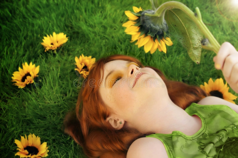 Download Little Girl And Sunflower Royalty Free Stock Photography - Image: 7143377