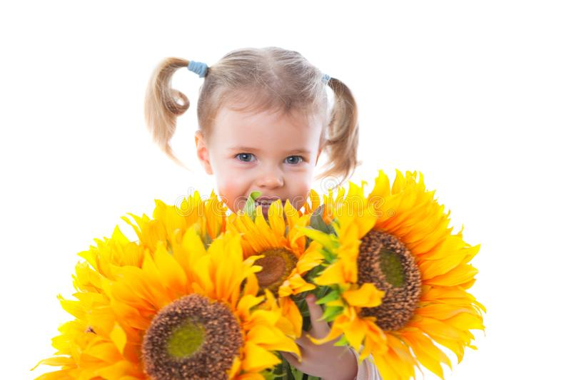 Little girl with sunflowers stock photography