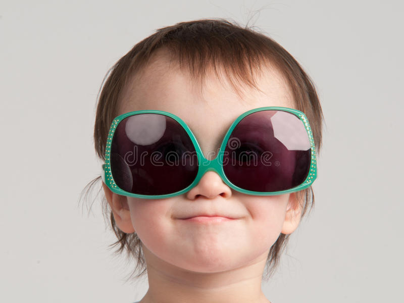 Little girl with sunglasses royalty free stock image