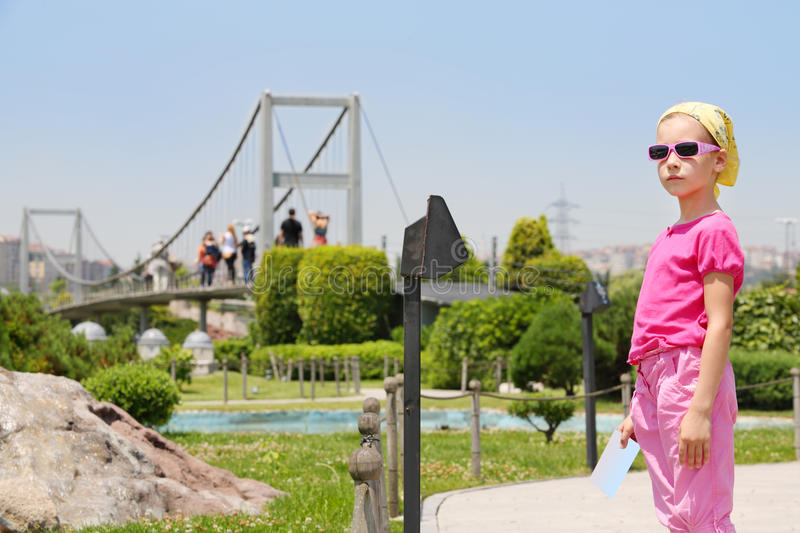 Little girl in sunglasses looks at distance in Miniaturk Museum royalty free stock image