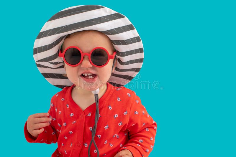 Child in sunglasses and hat royalty free stock photos