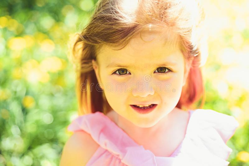 Little girl in sunny spring. face skincare. allergy to flowers. Small child. Natural beauty. Childrens day. Springtime royalty free stock photography