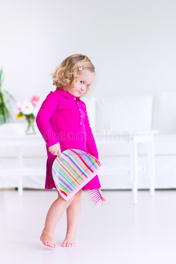 Little girl sweeping the floor stock image