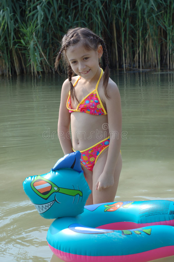 A little girl swimming royalty free stock image