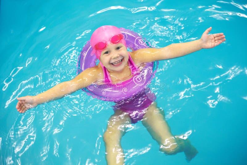 Download Little girl swimming stock image. Image of family, glasses - 28802483