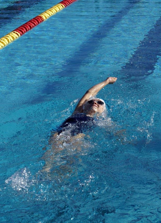 Little Girl Swimming Backstroke. Little girl swimming the backstroke at a swim meet royalty free stock photos