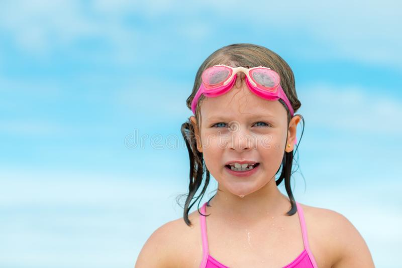 Little Girl in swimming goggles - after swimming royalty free stock photo