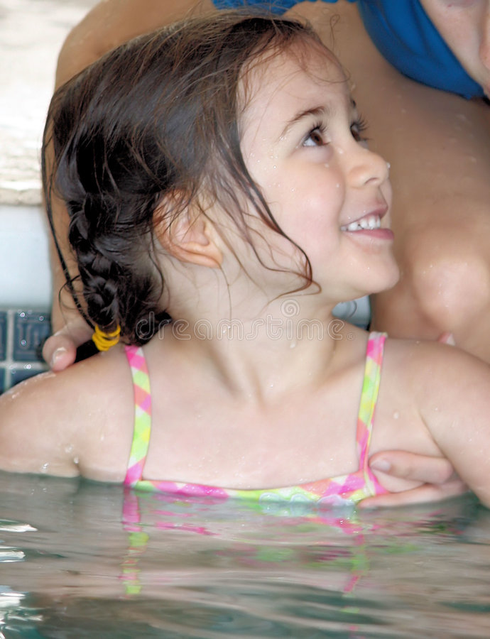 Little girl swimming lesson