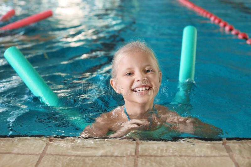 Little girl with swimming noodle royalty free stock photos