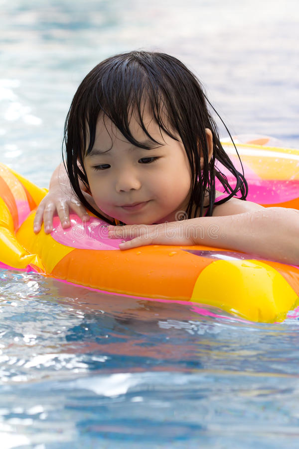 Download Little Girl In Swimming Pool Stock Image - Image of toys, children: 20987611
