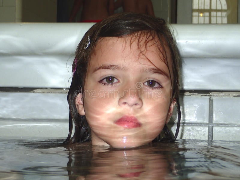 Little girl at the swimming pool stock image