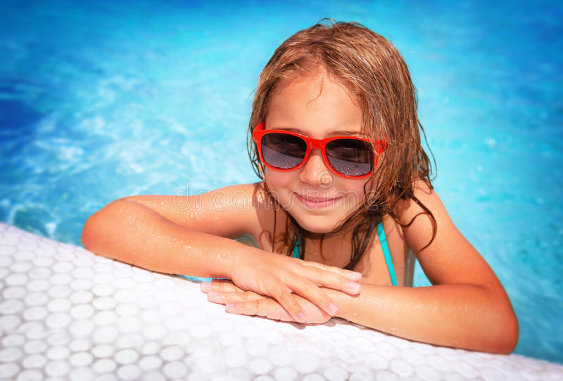 Little girl in swimming pool royalty free stock image