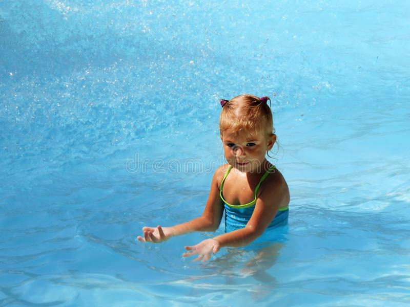 Little girl swimming in the sea royalty free stock image