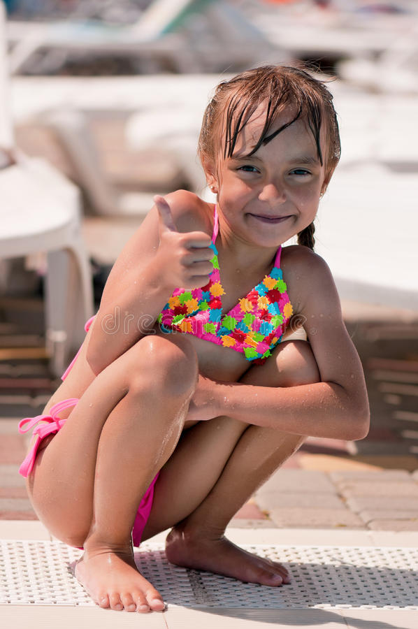 Little girl in swimsuit royalty free stock photography