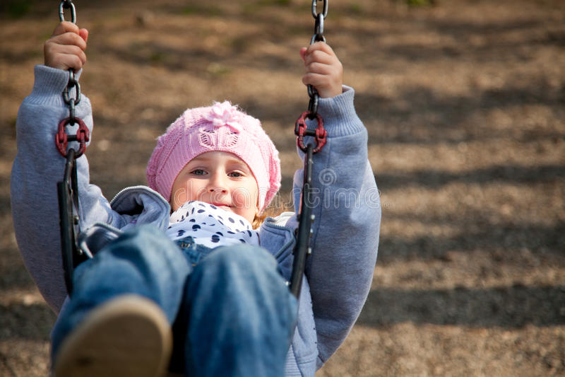 Little girl in the swing stock image