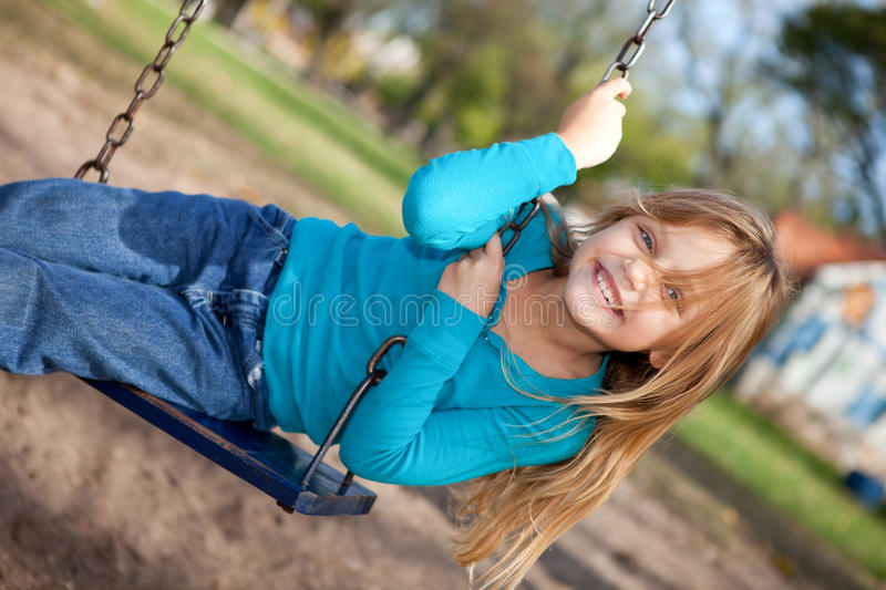 Download Little girl on a swing stock image. Image of swing, face - 24582569