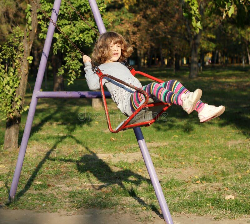 Download Little girl on swing stock photo. Image of childhood - 27436100
