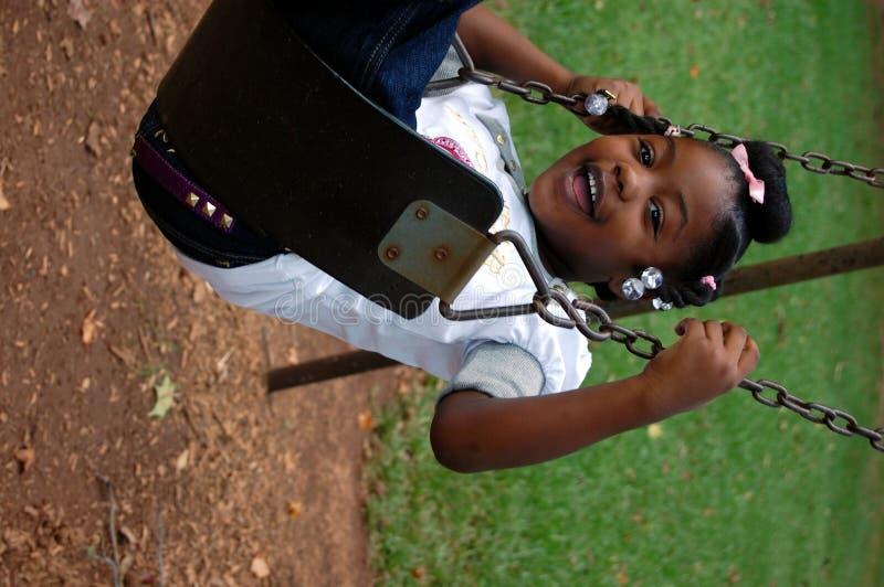 Little girl in swing royalty free stock image