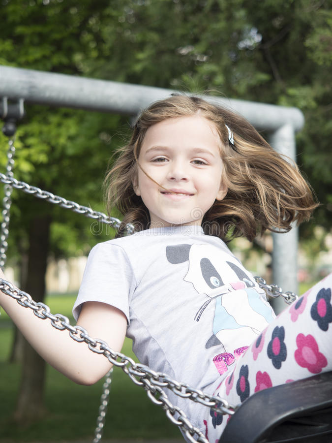 Little girl in the swing royalty free stock photography