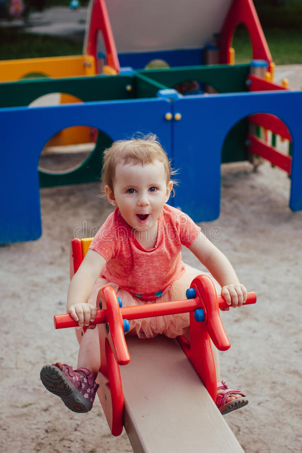 Little girl on the swing is happy, laughing stock photo