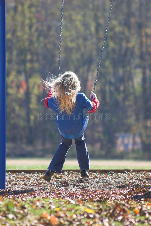 Little Girl Swinging royalty free stock photography