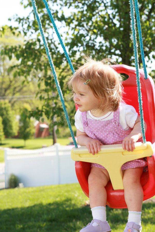 Download Little Girl Swinging stock photo. Image of outdoor, outside - 5300604