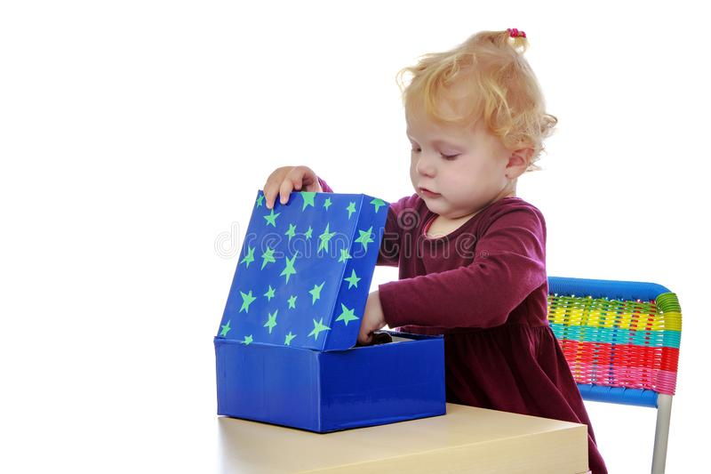 The little girl at the table works with the Montessori material. stock images
