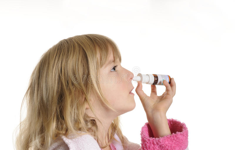 Little girl takes nose drops. Blond little girl takes nose drops stock photography