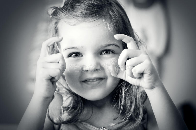 Little Girl Taking a Picture. Cute little girl acting like a photographer stock photos