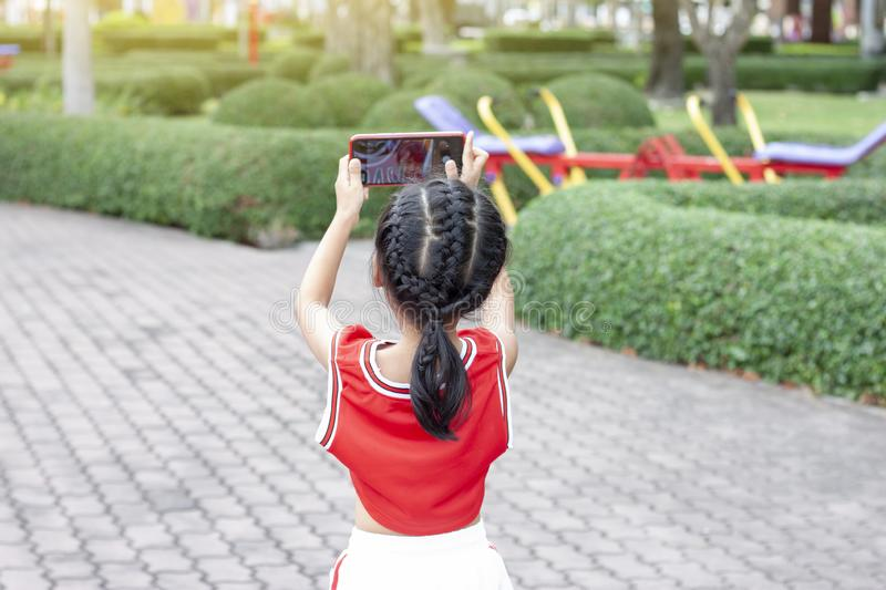 Little girl taking a selfie while going to exercise. royalty free stock image