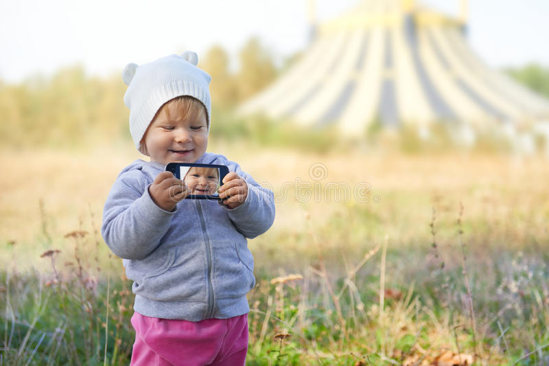 Little girl taking selfie near the circus royalty free stock photography